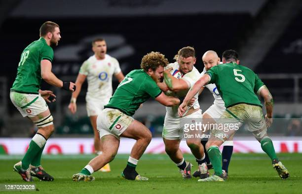 Will Stuart of England is tackled by Finlay Bealham and James Ryan of Ireland during the England v Ireland Quilter International match, part of the...