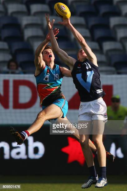 Will Sutherland of Vic Metro marks the ball against Michael CARROLL of the Allies during the U18 AFL Championships match between Vic Metro and the...