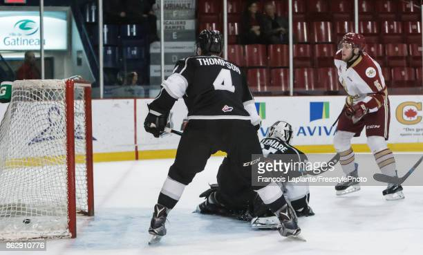 Will Thompson and Mathieu Bellemare of the Gatineau Olympiques looks in the net as Dawson Theede of the Acadie-Bathurst Titan scores his second goal...
