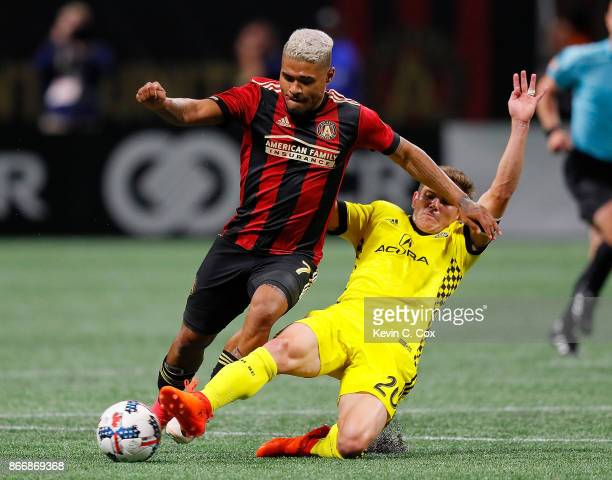 Will Trapp of Columbus Crew challenges Josef Martinez of Atlanta United during the Eastern Conference knockout round at MercedesBenz Stadium on...