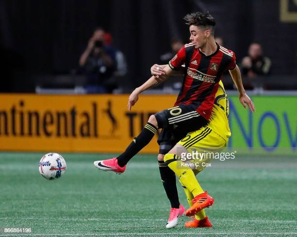 Will Trapp of Columbus Crew challenges Miguel Almiron of Atlanta United during the Eastern Conference knockout round at MercedesBenz Stadium on...