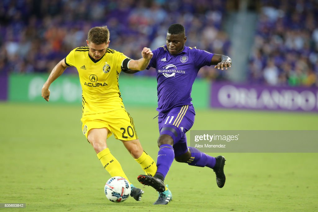 Will Trapp #20 of Columbus Crew SC and Carlos Rivas #11 of Orlando City SC fight for the ball during a MLS soccer match between the Columbus Crew SC and the Orlando City SC at Orlando City Stadium on August 19, 2017 in Orlando, Florida.