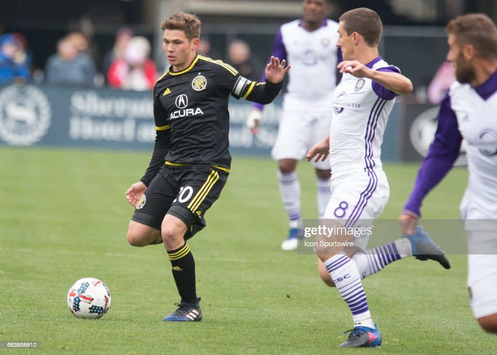 Will Trapp #20 of Columbus Crew SC dribbles the ball during the first half of the match between the Columbus Crew SC and the Orlando City SC held at MAPFRE Stadium in Columbus, Ohio on April 1st 2017.