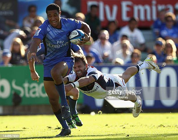 Will Tupou of the Force avoids a tackle by Lachlan Mitchell of the Rebels during the round 13 Super Rugby match between the Western Force and the...