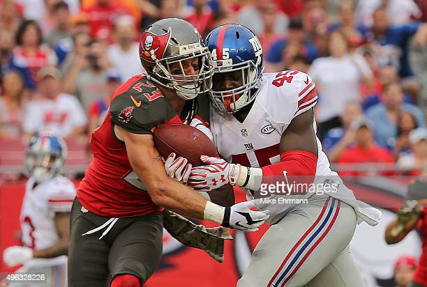 Will Tye of the New York Giants and Chris Conte of the Tampa Bay Buccaneers fight for a pass during a game at Raymond James Stadium on November 8...