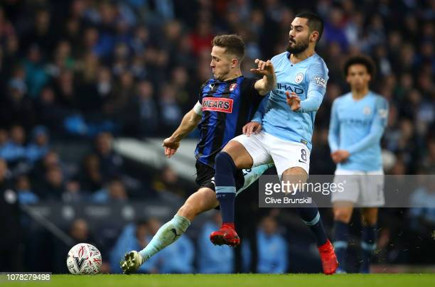 Will Vaulks of Rotherham United is challenged by Ilkay Gundogan of Manchester City during the FA Cup Third Round match between Manchester City and...