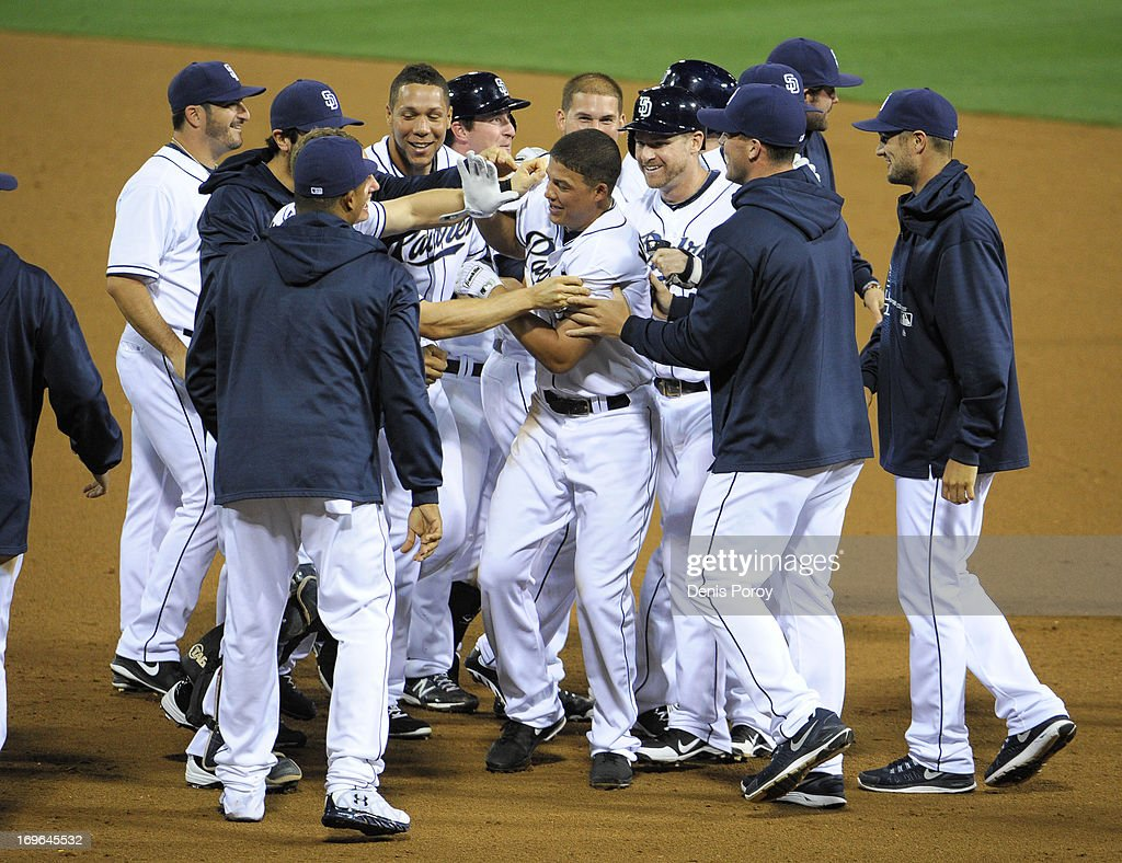 Will Venable #25 of the San Diego Padres, center, is congratulated by teammates after hitting a walk-off RBI single during the tenth inning of a baseball game against the Seattle Mariners at Petco Park on May 29, 2013 in San Diego, California. The Padres won 3-2.