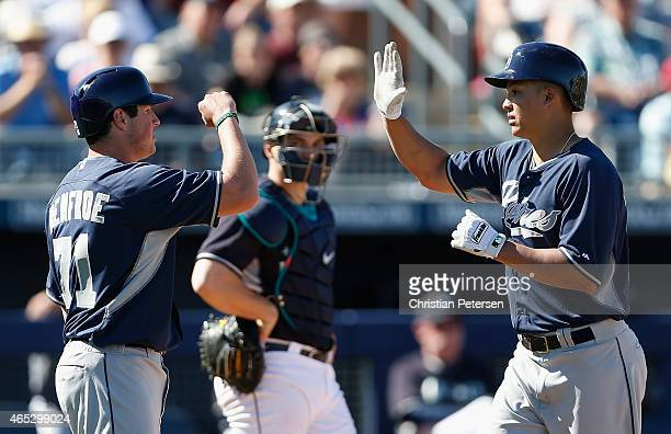 Will Venable of the San Diego Padres highfives Hunter Renfroe at home plate after Venable hit a tworun home run against the Seattle Mariners during...