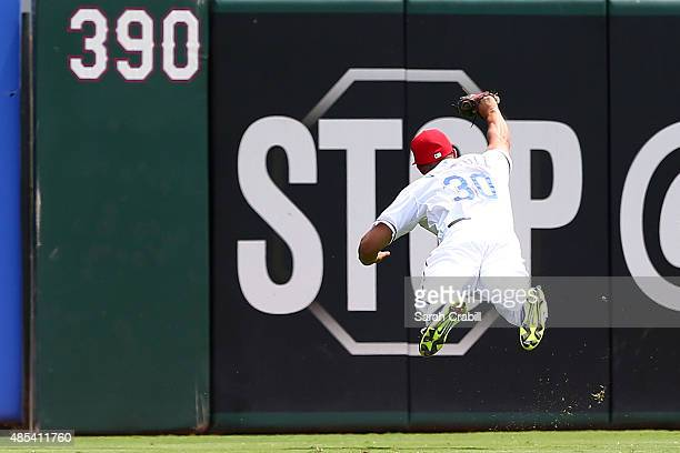 Will Venable of the Texas Rangers makes a diving catch in the second inning during a game against the Toronto Blue Jays at Globe Life Park in...