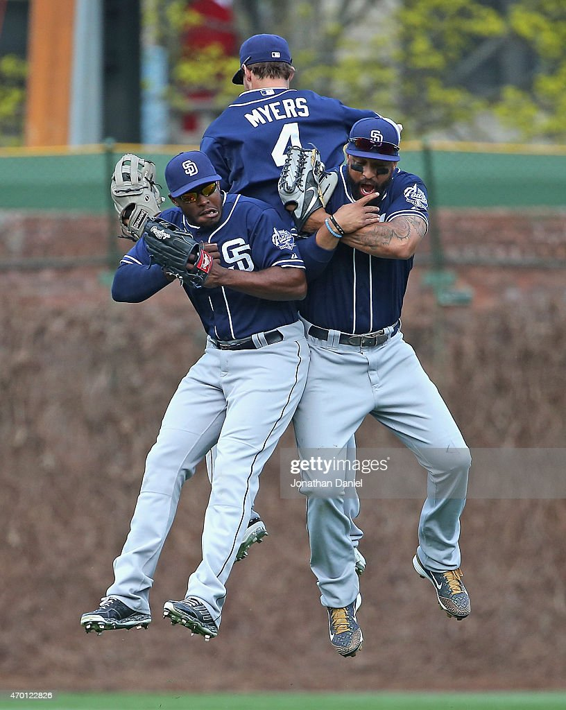 Will Venable #25, Wil Myers #4 and Matt Kemp #27 of the San Diego Padres celebrate a win over the Chicago Cubs at Wrigley Field on April 17, 2015 in Chicago, Illinois. The Padres defeated the Cubs 5-4.