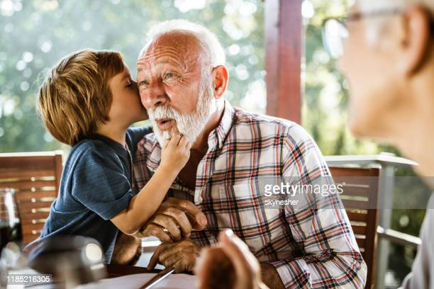 i will whisper you something granddad! - whispering stock pictures, royalty-free photos & images