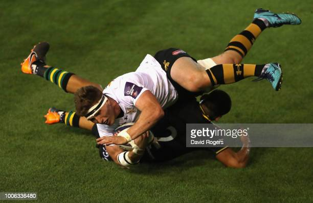 Will Wilson of Wasps dives over for a try in the match against Northampton Saints during day one of the Premiership Rugby 7's at Franklin's Gardens...