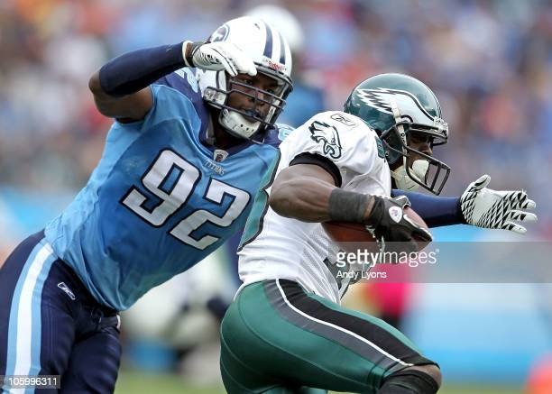 Will Witherspoon of the Tennessee Titans tackles Jeremy Maclin of the Philadelphia Eagles during the NFL game at LP Field on October 24 2010 in...