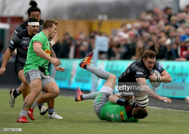 Will Witty of Newcastle Falcons tackled by Mike Brown of Harlequins during the Gallagher Premiership Rugby match between Newcastle Falcons and...