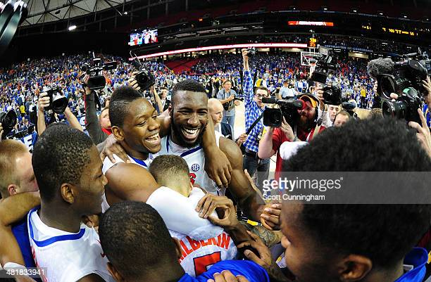 Will Yeguete and Patric Young of the Florida Gators celebrate after the SEC Men's Basketball Tournament against Kentucky Wildcats at the Georgia Dome...