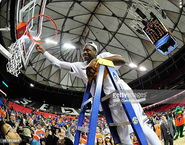 Will Yeguete of the Florida Gators celebrates after the SEC Men's Basketball Tournament against Kentucky Wildcats at the Georgia Dome on March 16...