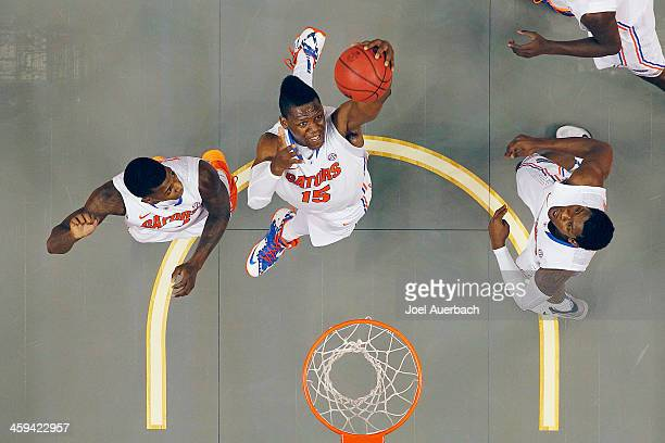 Will Yeguete of the Florida Gators controls the defensive rebound during first half action against the Fresno State Bulldogs during the MetroPCS...