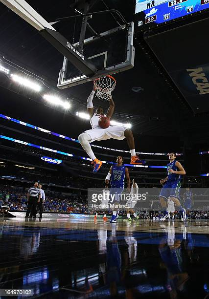 Will Yeguete of the Florida Gators dunks in the second half against the Florida Gulf Coast Eagles during the South Regional Semifinal round of the...