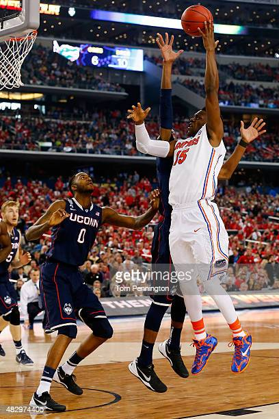 Will Yeguete of the Florida Gators goes up for a shot as DeAndre Daniels of the Connecticut Huskies defends during the NCAA Men's Final Four...
