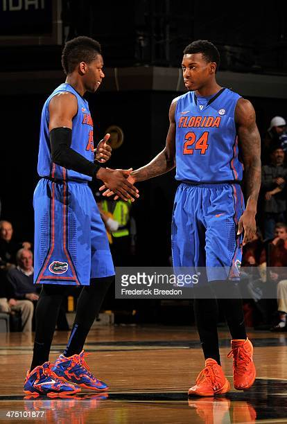 Will Yeguete of the Florida Gators high fives teammate Casey Prather during a game against the Vanderbilt Commodores at Memorial Gym on February 25...