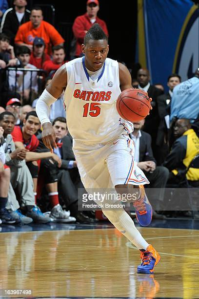 Will Yeguete of the Florida Gators plays against the Ole Miss Rebels during the SEC Baskebtall Tournament Championship Game at Bridgestone Arena on...