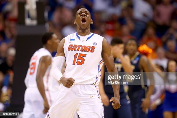 Will Yeguete of the Florida Gators reacts in the second half while taking on the Pittsburgh Panthers during the third round of the 2014 NCAA Men's...