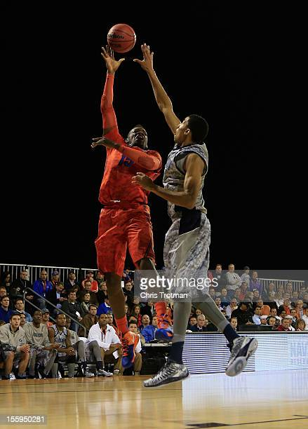Will Yeguete of the Florida Gators shoots over Otto Porter of the Georgetown Hoyas during the NavyMarine Corps Classic aboard the USS Bataan at...