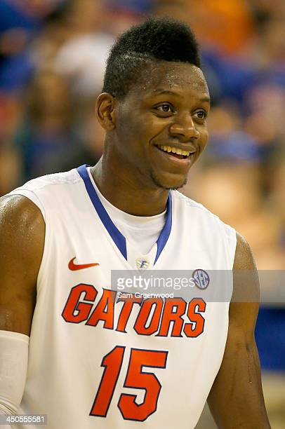 Will Yeguete of the Florida Gators smiles during the game against the Arkansas Little Rock Trojans at Stephen C O'Connell Center on November 16 2013...
