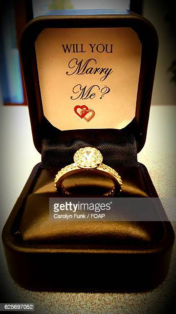 will you marry me text with diamond ring on box - engagement ring box stock photos and pictures
