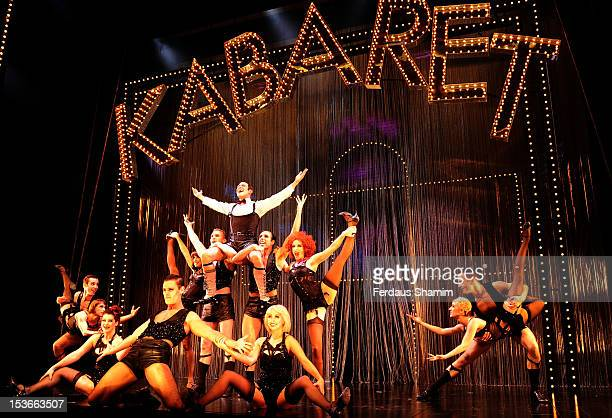 Will Young as Emcee and Ensemble and cast of Cabaret perform during a photocall for 'Cabaret' at The Savoy Theatre on October 8 2012 in London England
