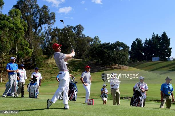 Will Zalatoris of Team USA watches his tee shot with Cameron Champ on their way to beating David Boote and Jack Davidson of Team Great Britain and...