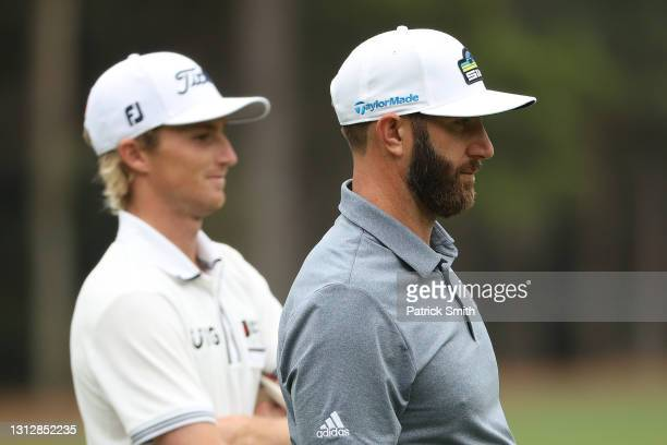 Will Zalatoris of the United States and Dustin Johnson of the United States look on during the second round of the RBC Heritage on April 16, 2021 at...