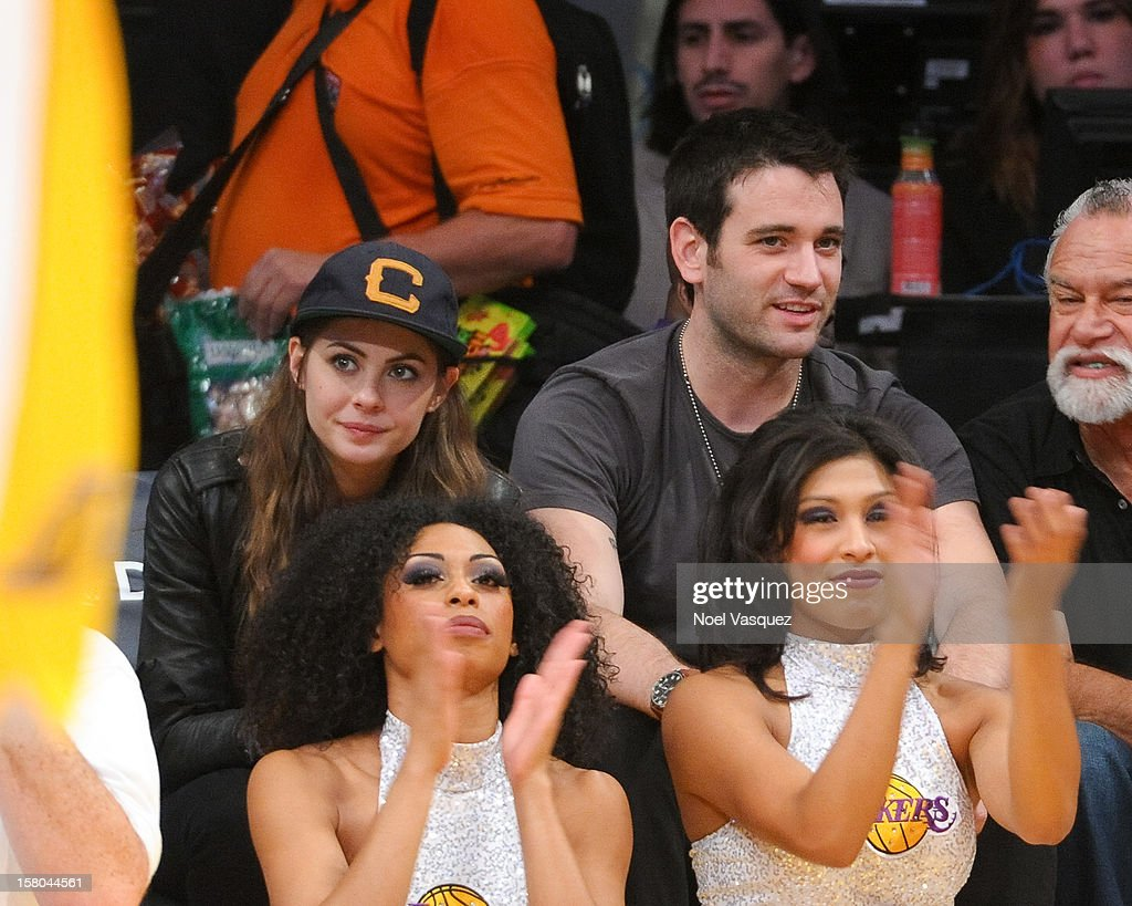 Willa Holland (L) and Colin Donnell attend a basketball game between the Utah Jazz and the Los Angeles Lakers at Staples Center on December 9, 2012 in Los Angeles, California.
