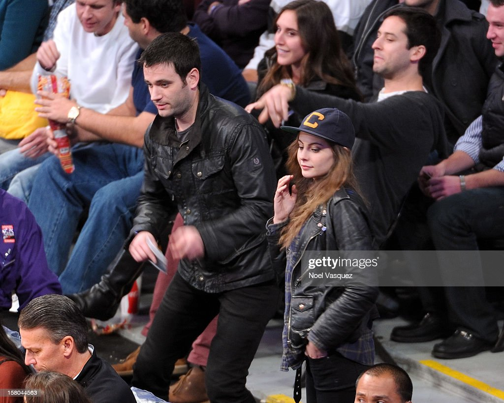 Willa Holland (R) and Colin Donnell attend a basketball game between the Utah Jazz and the Los Angeles Lakers at Staples Center on December 9, 2012 in Los Angeles, California.