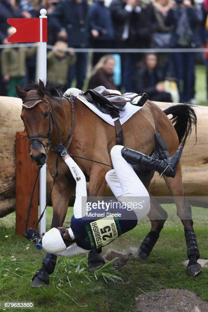 Willa Newton of Great Britain riding Chance Remark falls at fence fifteen during the Cross Country test on day four of Badminton Horse Trials on May...