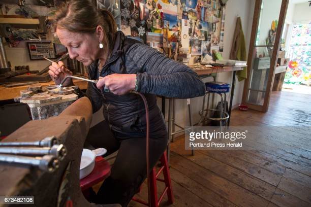 Willa Wirth owns a small shop on Munjoy Hill where she creates her own jewelry forging soldering and forming sterling silver wire Wirth uses a...