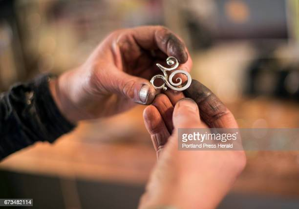 Willa Wirth owns a small shop on Munjoy Hill where she creates her own jewelry forging soldering and forming sterling silver wire Wirth looks at a...