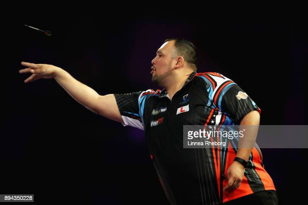 Willard Bruguier of USA in action during his first round match against Cody Harris of New Zealand on day four of the 2018 William Hill PDC World...