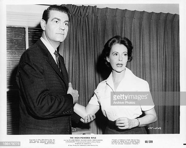 Willard Parker holding the arm of Allison Hayes in a scene from the film 'The High Powered Rifle', 1960.