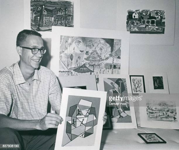 Willard R Smith III teacher at York Junior High School in Thornton and member of the Denver Art Club shows a few of the paintings he'll display at...