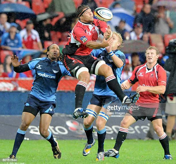 Willem Alberts of Lions and Dewald Potgieter of Bulls go for the ball during the round three Super 14 match between the Lions and Bulls at Coca-Cola...