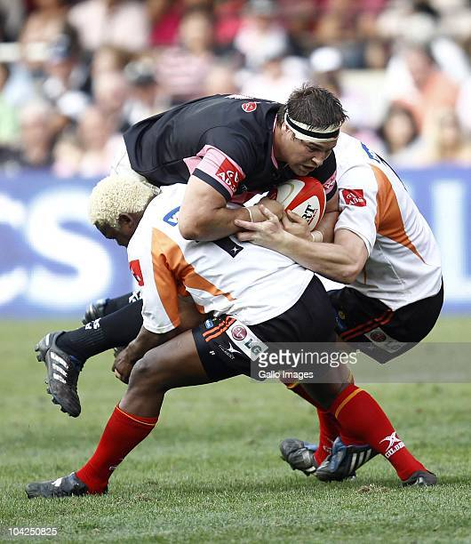 Willem Alberts of the Sharks is tackled during the Absa Currie Cup match between the Sharks and Vodacom Free State Cheetahs at Absa Stadium on...