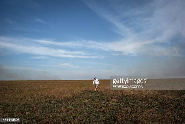 Willem Boulanger, a Belgian living in Democratic Republic of Congo, walks in his game reserve project about 10 km from Kolwezi, on May 30, 2015....
