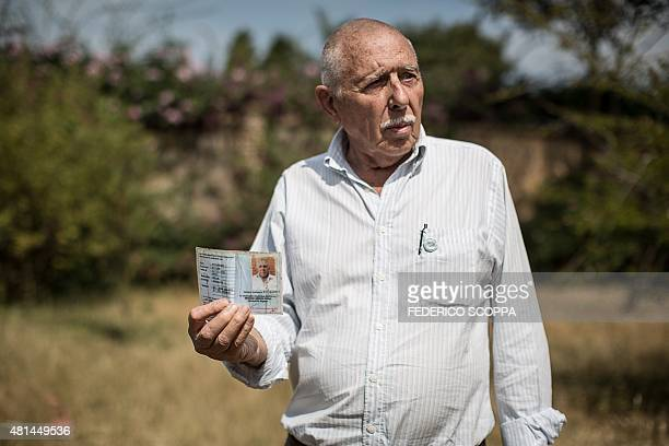 Willem Boulanger, a Belgian living in Democratic Republic of Congo, poses showing his state dignitary card in Kolwezi, on May 30, 2015. Boulanger...