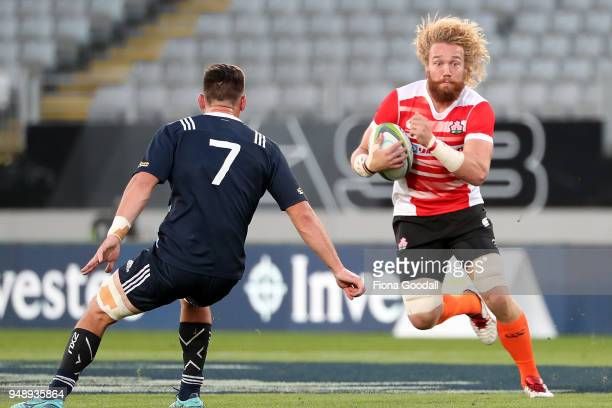 Willem Britz of Japan A is tackled by Antonio Kiri Kiri of the Blues A during the curtain raiser match between Japan A and Blues A ahead of the round...