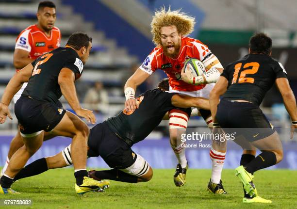 Willem Britz of Sunwolves is tackled by Leonardo Senatore of Jaguares during the Super Rugby match between Jaguares and Sunwolves at Estadio Jose...
