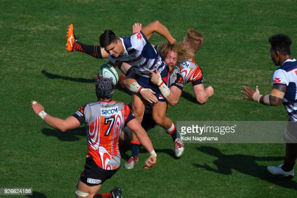 Willem Britz of Sunwolves makes a tackle on Jack Maddocks of Rebels during the Super Rugby round 3 match between Sunwolves and Rebels at the Prince...