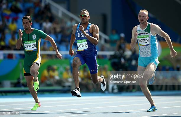 Willem Coertzen of South Africa, Jeremy Taiwo of the United States and Leonid Andreev of Uzbekistan compete in the Men's Decathlon 100m heats on Day...