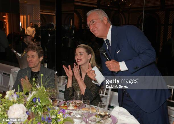 Willem Dafoe Amber Heard and CEO of Finch Partners Charles Finch attend the 10th Annual Filmmakers Dinner hosted by Charles Finch Edward Enninful and...
