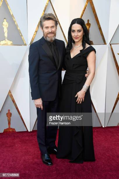 Willem Dafoe and Giada Colagrande attend the 90th Annual Academy Awards at Hollywood Highland Center on March 4 2018 in Hollywood California